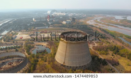 Chernobyl nuclear power plant. Cooling tower overlooking the nuclear power plant in Chernobyl. View of the destroyed nuclear power plant. Chernobyl nuclear power plant, Ukrine. Aerial view. #1474489853