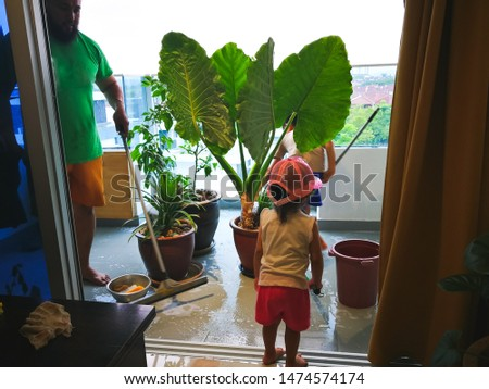 Bangi, Malaysia - August 1, 2019 : Family cleaning the balcony at home. #1474574174