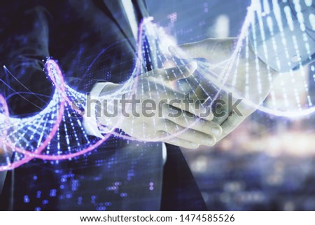 Multi exposure of DNA drawing hologram on city view background with handshake. Concept of education #1474585526
