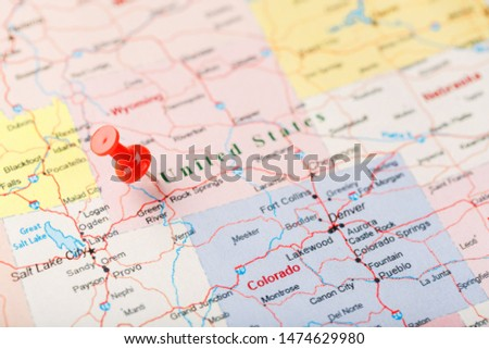 Red clerical needle on a map of United States, Wyoming and the capital Cheyenne. Close up map of wyoming with red tack, US map pin #1474629980