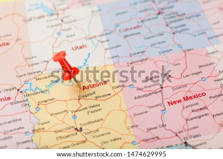 Red clerical needle on a map of USA, Arizona and the capital Phoenix. Closeup Map Arizona with Red Tack #1474629995