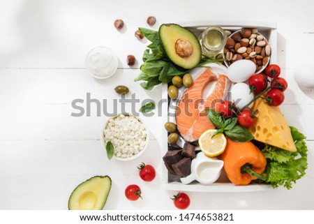 Ketogenic low carbs diet - food selection on white wooden background. Balanced healthy organic ingredients of high content of fats. Nutrition for the heart and blood vessels. Meat, fish and vegetables #1474653821