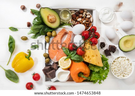Ketogenic low carbs diet - food selection on white wooden background. Balanced healthy organic ingredients of high content of fats. Nutrition for the heart and blood vessels. Meat, fish and vegetables #1474653848