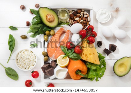 Ketogenic low carbs diet - food selection on white wooden background. Balanced healthy organic ingredients of high content of fats. Nutrition for the heart and blood vessels. Meat, fish and vegetables #1474653857