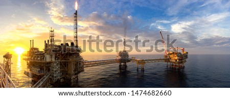 Panorama view of offshore oil and Gas processing platform in sunset time, Concept of exploration and petroleum production industry in the sea. Royalty-Free Stock Photo #1474682660