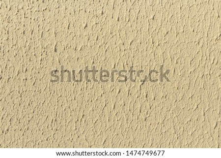Beautiful horizontal texture of part of old concrete wall painted in yellow and white color and with holes on the photo #1474749677