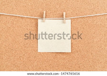 Corkboard with stickers fixed by a pin. Square shaped sheets stuck on a billboard by colored thumbtacks. Notice board with empty reminder note. #1474765616