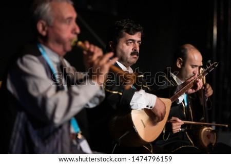 "Neustadt in Holstein, Germany - August 03, 2019, European Folklore Festival, ""Atakoy Halk Oyunlan G. S. K. Dernegi"" from Istanbul, Turkey. Traditional musician playing baglama saz. #1474796159"