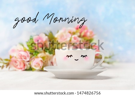 Good Morning. white cup with cute smile face. Cup of tea or Coffee and flowers. minimal style, romantic mood