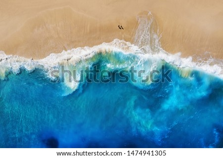Coast as a background from top view. Turquoise water background from top view. Summer seascape from air. Nusa Penida island, Indonesia. Travel - image Royalty-Free Stock Photo #1474941305