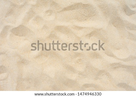 Close-up Shot. Yellow beach sand texture as background. Royalty-Free Stock Photo #1474946330