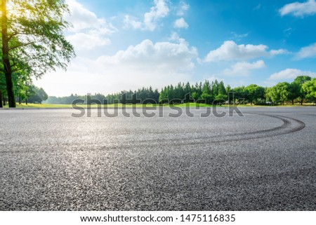 Asphalt race track and green woods nature landscape in summer #1475116835
