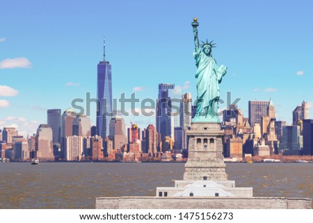 The Statue of Liberty with the One world Trade building center over hudson river and New York cityscape background, Landmarks of lower manhattan New York city. #1475156273