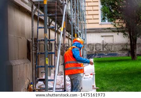 Builder concept. Builder unload truck. Builder in working uniform. Builder carry bricks. Safety comes first. #1475161973
