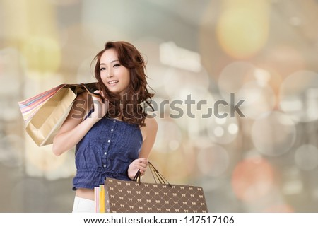 Modern Asian woman shopping in the mall and looking back at you, closeup portrait. #147517106