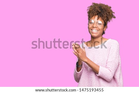 Beautiful young african american woman wearing glasses over isolated background Clapping and applauding happy and joyful, smiling proud hands together #1475193455