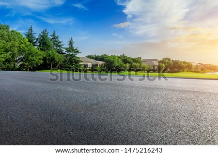 Empty asphalt road and beautiful natural scenery in city park #1475216243