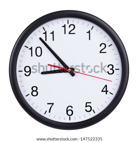 Round office wall clock shows five to nine #147522335