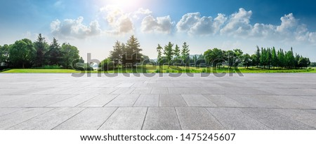 Empty square floor and green woods natural scenery in city park #1475245607