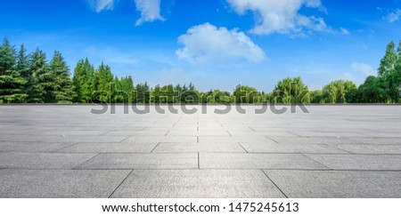 Empty square floor and green woods natural scenery in city park #1475245613