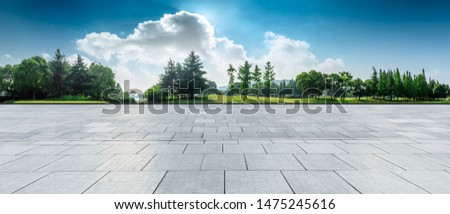 Empty square floor and green woods natural scenery in city park #1475245616