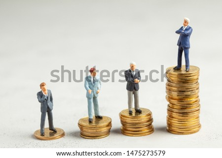 Successful businessman with big profits at the top of the stairs by coins and less successful businessmen with small companies. Adequate investment in the company #1475273579