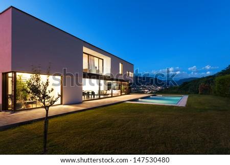 Modern villa with pool, night scene #147530480