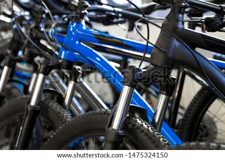 Variety of new bikes in line in bike shop Royalty-Free Stock Photo #1475324150
