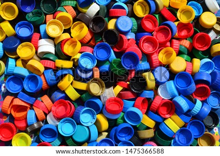 Plastic bottle caps background. Cap material is recyclable.Remove lids from plastic bottles before recycling them. Recycling collection and processing plastic bottle caps  #1475366588