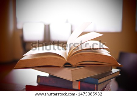 Books on study desk in a library, education or academic concept picture of learning materials. School, college, or university conceptual image. Test or exam preparation prior to the evaluation day.