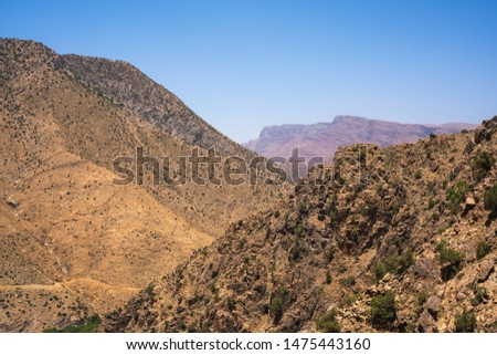 Mountainous moroccan landscape perfect as a background or as an advertisement for tourist products. #1475443160