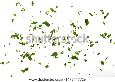 Fresh green chopped parsley leaves isolated on white background and texture, top view. Chopped parsley on a white background isolated. Chopped Parsley Leaves. Fresh Herbs  #1475447726