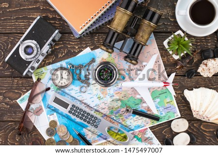 Accessories and items for traveling on the table in composition #1475497007