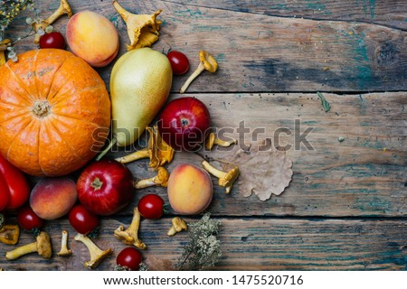 Autumn seasonal vegetables and fruits (pumpkin, pear, apples, corn, chanterelles). Autumn products from the farm, or garden. Vegan eco concept. Copy space. Royalty-Free Stock Photo #1475520716