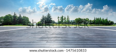 Empty wooden square and green woods natural scenery in city park #1475610833