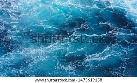 Abstraction of sea foam in the ocean. Dark water, storm waves #1475619158