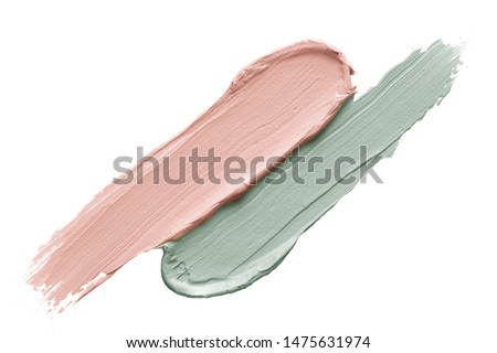 Color corrector strokes isolated on white background. Green and pink color correcting cream concealer smudge smear swatch sample. Makeup base creamy texture. #1475631974