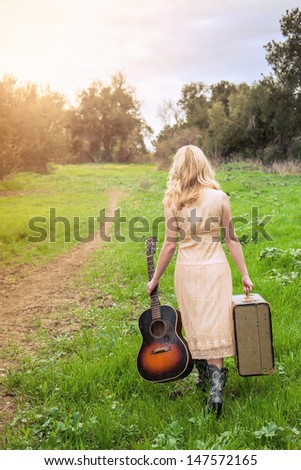 Girl playing Guitar in field #147572165
