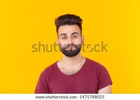 East asian handsome man wearing red tshirt on yellow background #1475788025