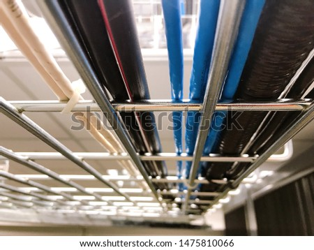 Large group of UTP cables, Ethernet cables and Fiber in cable tray. #1475810066
