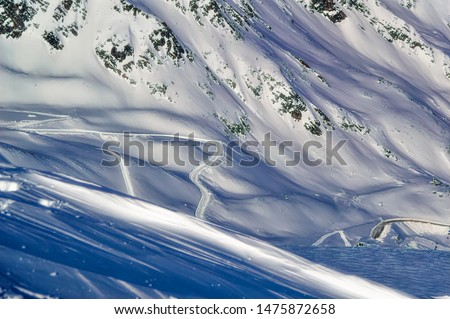 Snowy mountain road at very high altitude during winter day in Soelden, Austria. #1475872658