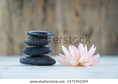stone spa and flower on the wooden table, Massage spa treatment concept. #1475942204
