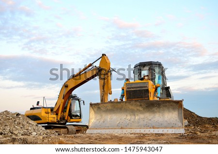 Track-type bulldozer, earth-moving equipment. Land clearing, grading, pool excavation, utility trenching, utility trenching and foundation digging during of large construction jobs.  #1475943047