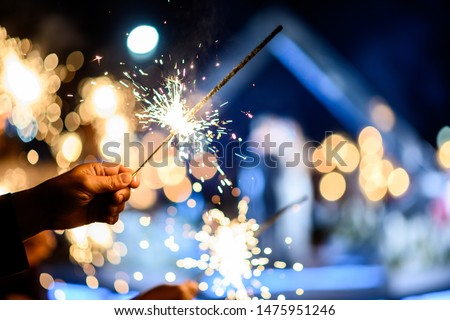Man hand holding a burning sparkler. Bengal fire #1475951246