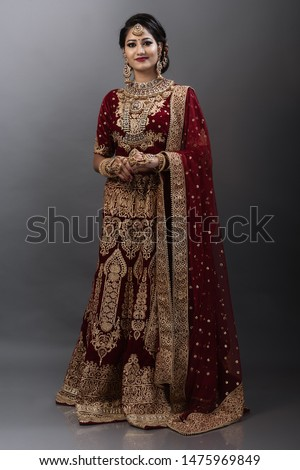 Young Indian female model in bridal wear and bridal jewelry #1475969849