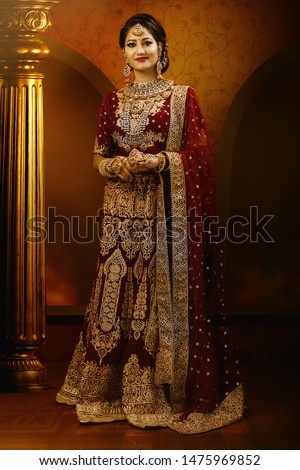 Young Indian female model in bridal wear and bridal jewelry #1475969852