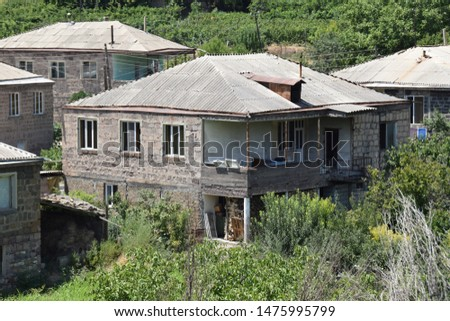Armenian village in barren dry landscape #1475995799