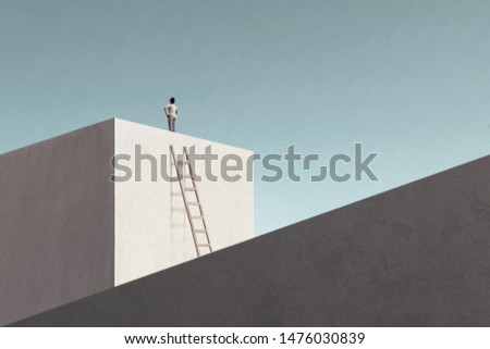 man on top of minimalist structure observing the sky #1476030839