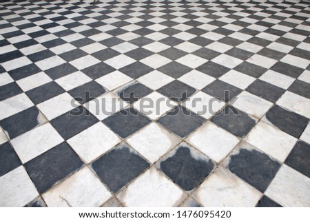 Checkered marble floor. Black and white squares staggered #1476095420