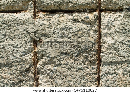 Close-up of an old ferro concrete wall with rusty reinforcement rods #1476118829